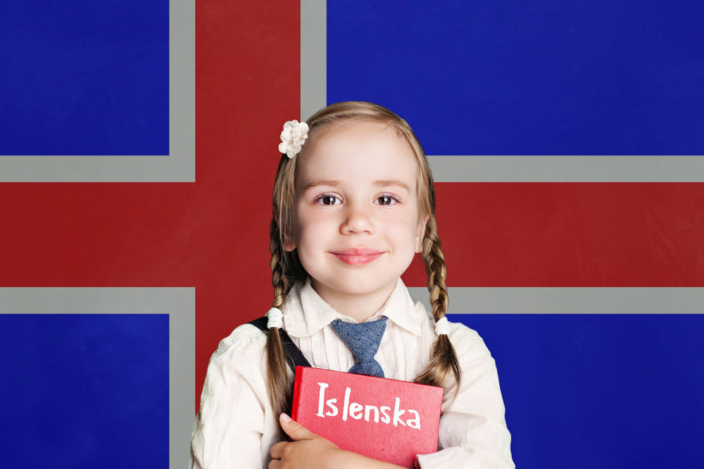 Young girl with a book of the Icelandic language